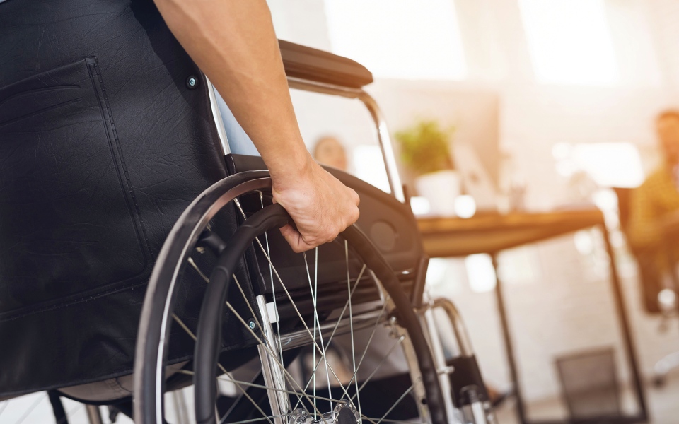 Person in wheelchair entering office